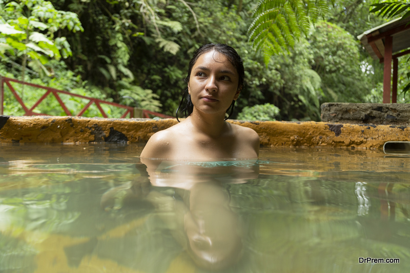 woman relaxing in natural water spring