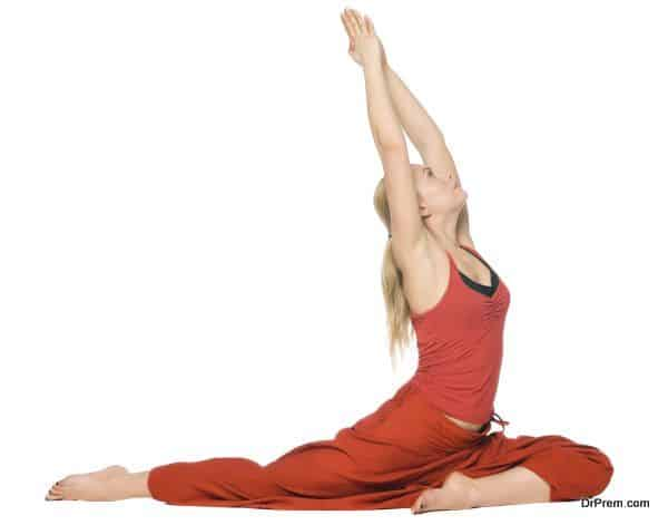 Beautiful girl doing yoga. Isolated on white