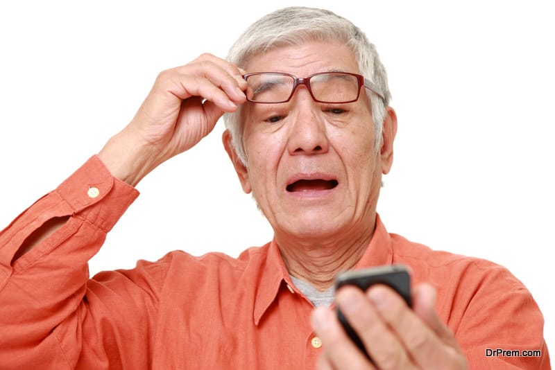 old man suffering from presbyopia