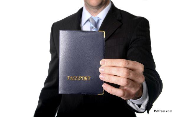 business man holding passport