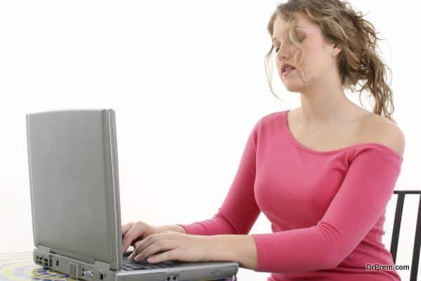 Beautiful Teen Girl Working On Laptop