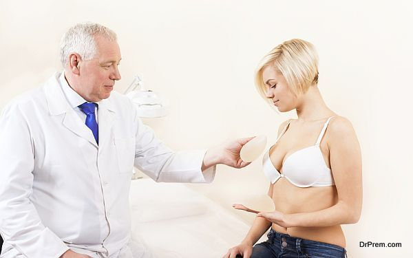 doctor show silicone breast implant young woman patient