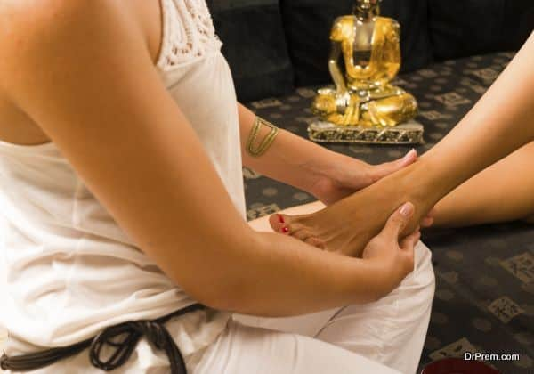 Oriental massage atmosphere with hands massaging a foot