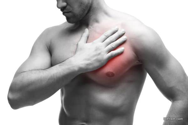 Heart attack. Young muscular man with chest pain isolated on white background