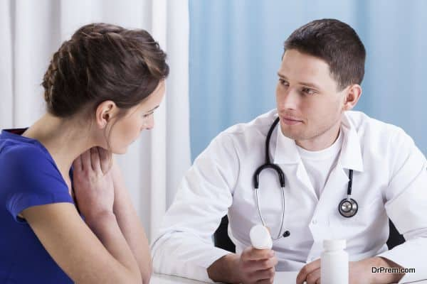 Young doctor recommending medicines to female patient
