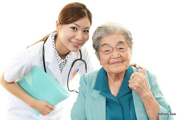 Smiling doctor and senior woman