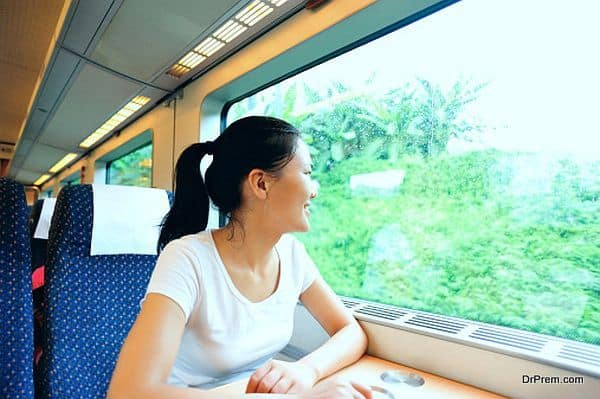 young woman looking out of the window in train