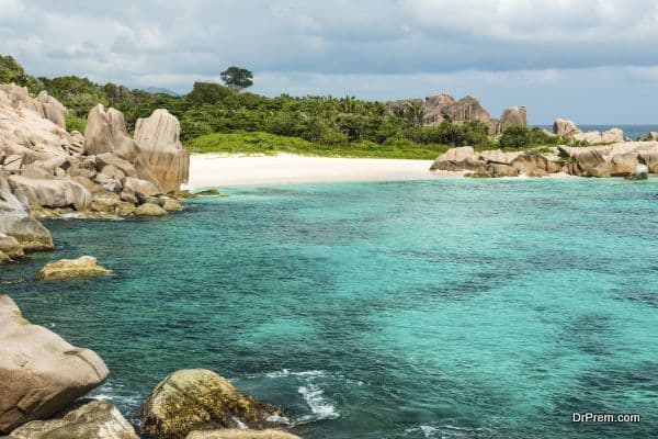 tropical turquoise sea with granite boulders