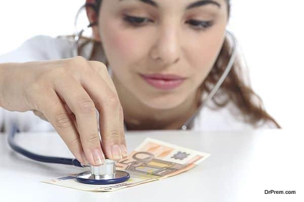 Doctor auscultating money economical crisis concept