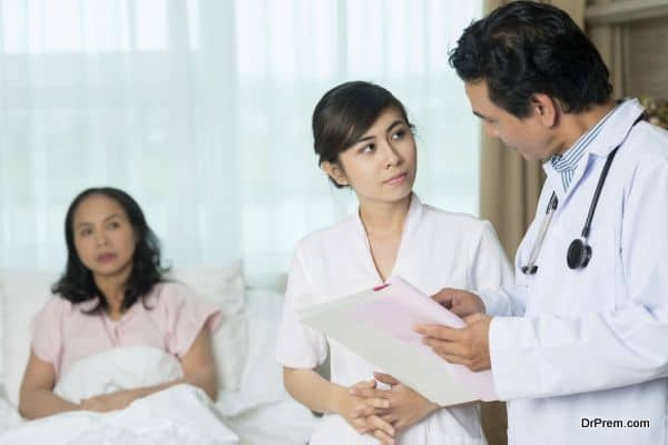 Doctor and nurse discussing diagnosis of the patient