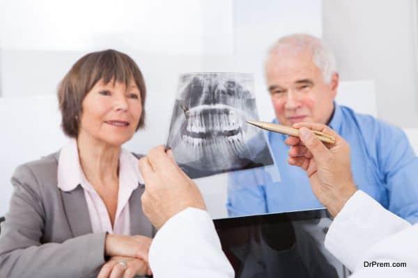 Dentist Explaining X-Ray To Senior Couple