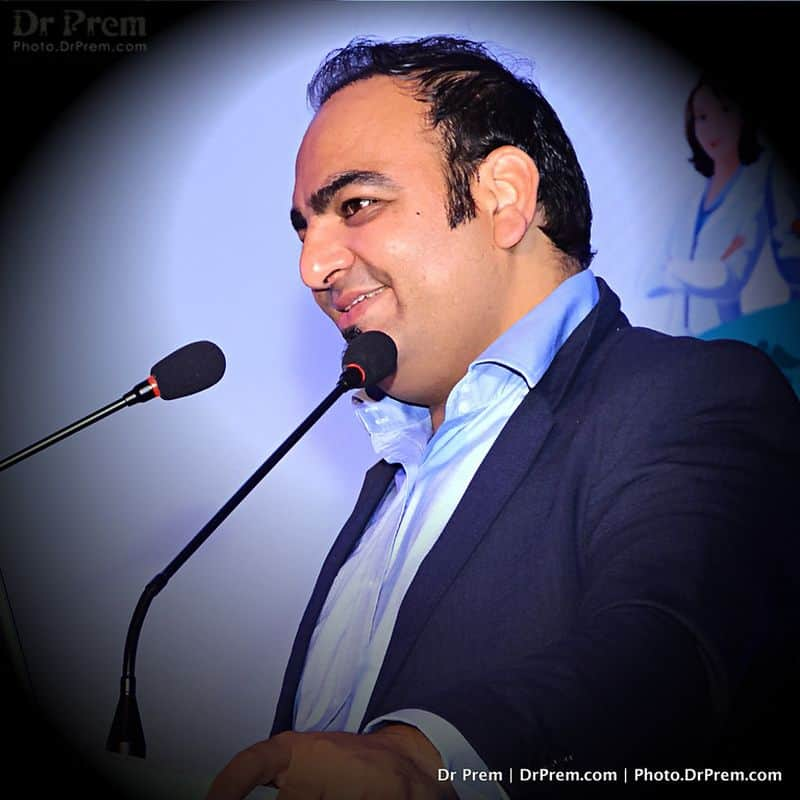 Dr Prem Smiling and Answering during a conference session