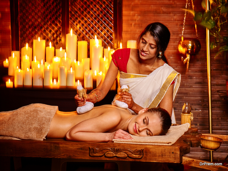 Woman having massage with pouch of rice