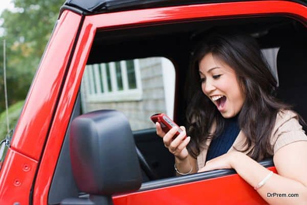 Woman holding mobile phone and looking surprised