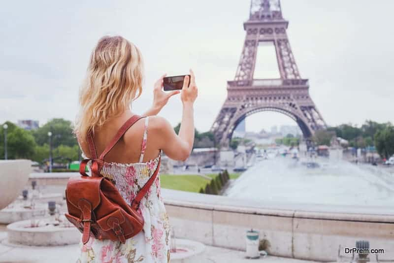 woman taking photo of Eiffel Tower
