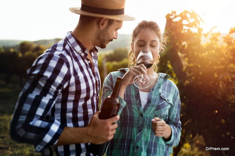 Beautiful woman tasting wine in wine grower vineyard
