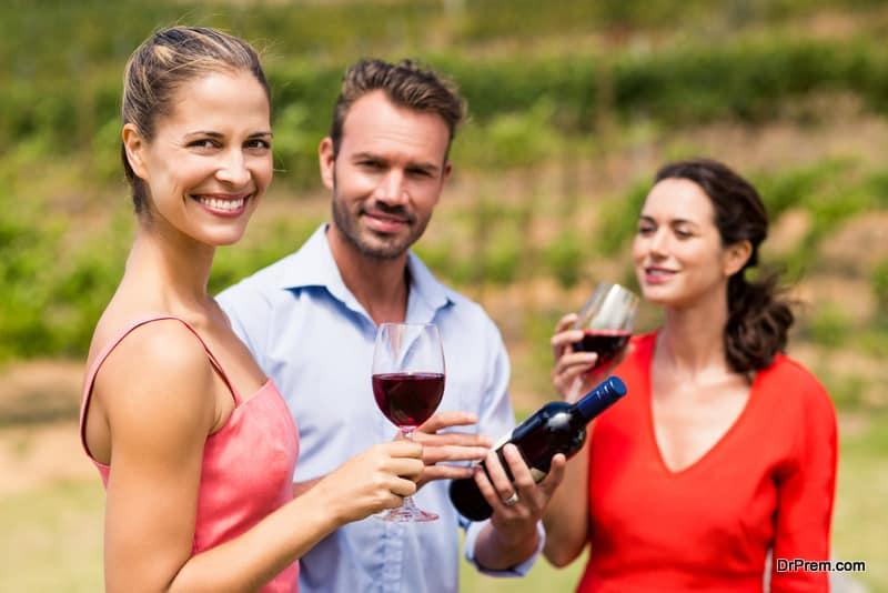 Happy friends having wine
