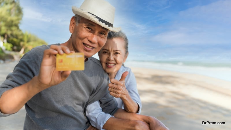 couple showing ATM card during tour