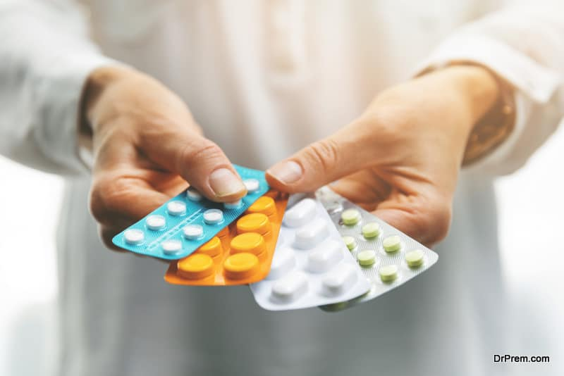 woman hands holding medicines