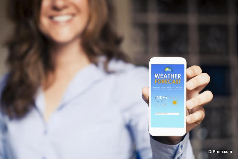 woman showing a mobile phone with weather forecast
