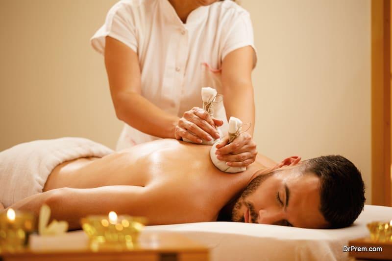 Relaxed man enjoying in back massage