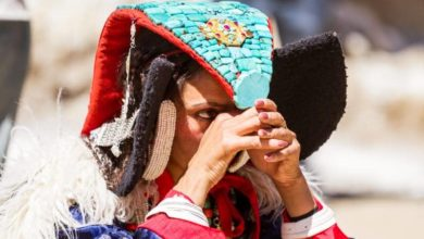"Ladakhi tribal woman in traditional clothing with headgear ""Peark"""
