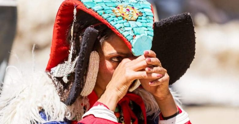 """Ladakhi tribal woman in traditional clothing with headgear """"Peark"""""""