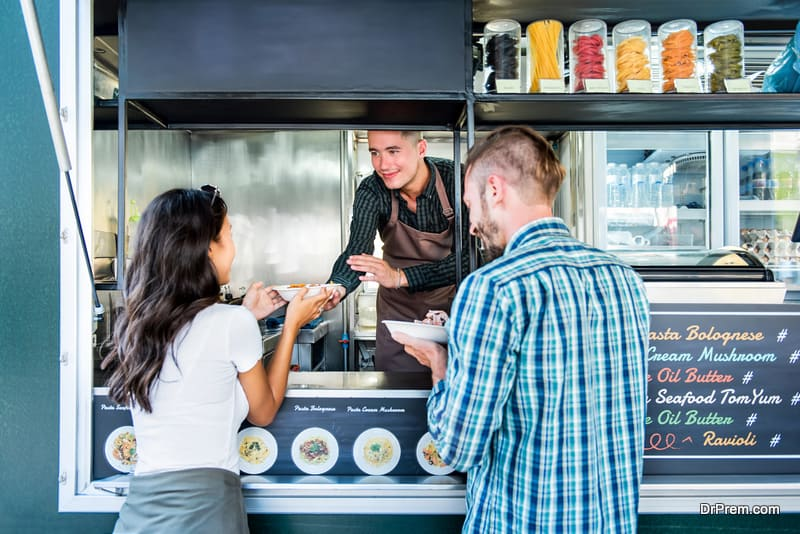 Couple buying pasta from food truck
