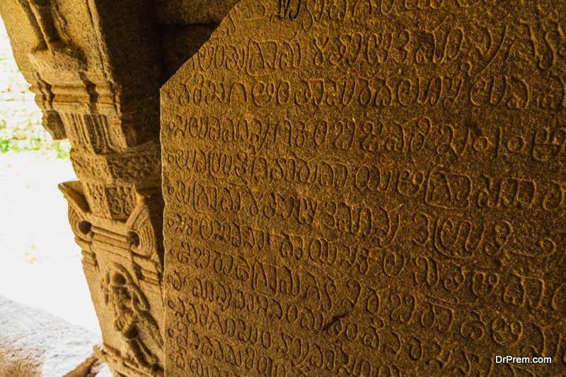Old inscription on a ancient temple in Hampi, India