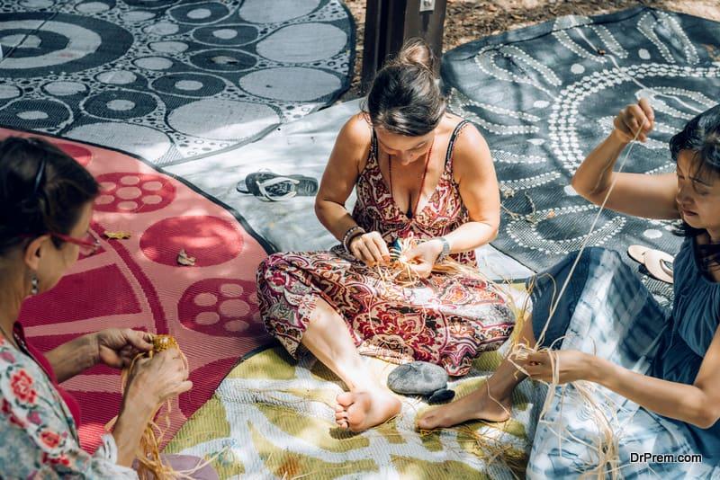 Females-weaving-baskets-on-craft-workshop