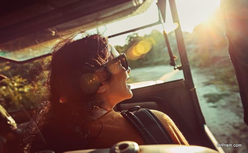 Happy woman on safari ride