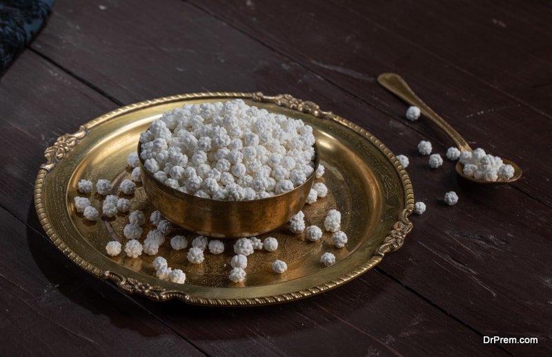 Heap of Makana or Ram Dana sugar coated sweet food item use as prasad in temples of india