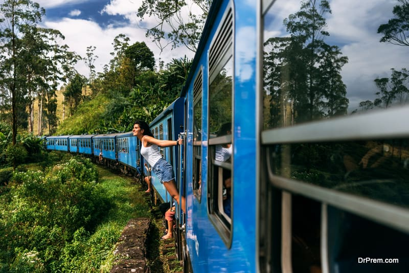 The girl travels by train