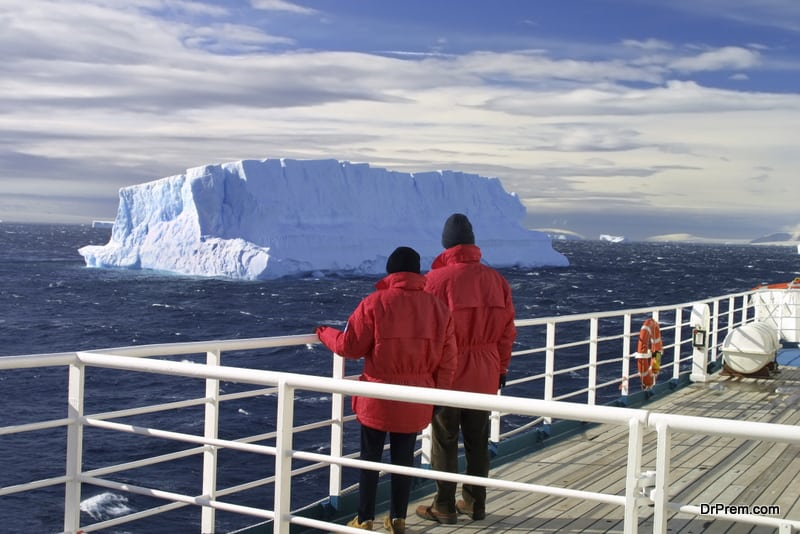Turists viewing iceberg, Antarctica