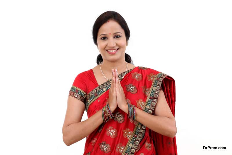 Traditional Indian woman woman greeting Namaste