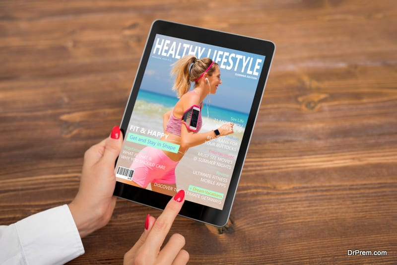 Woman reading healthy lifestyle magazine on tablet