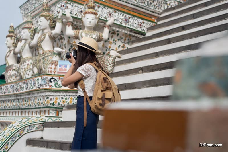 Young Asian women tourist taking photo picture with camera