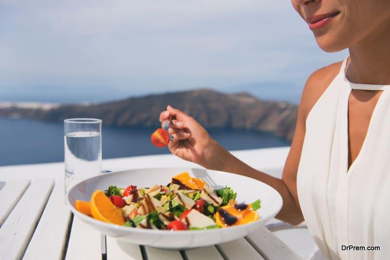 woman eating organic food during travel