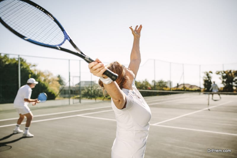 woman making a serve while playing tennis