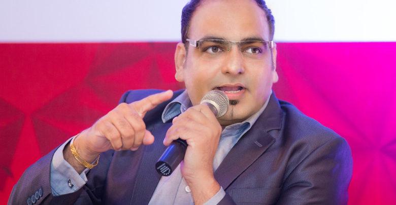Dr Prem responding in a technology Conference