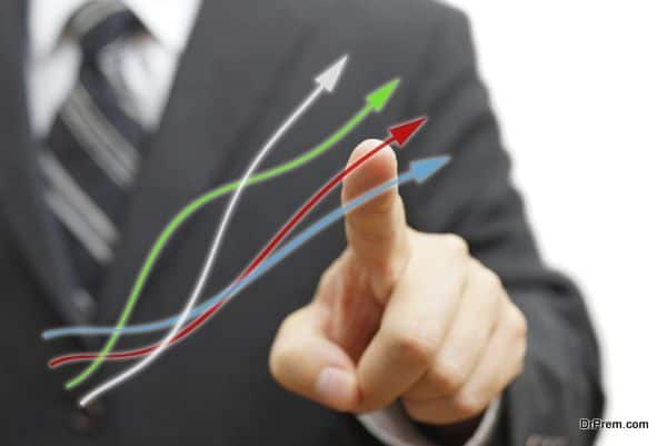 Businessman touching growing arrows. Positive trend concept