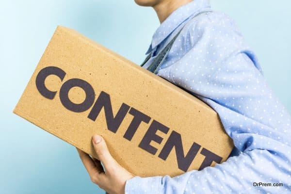 "Content marketing distribution concept. Woman carrying a box with the word ""content"" in front."