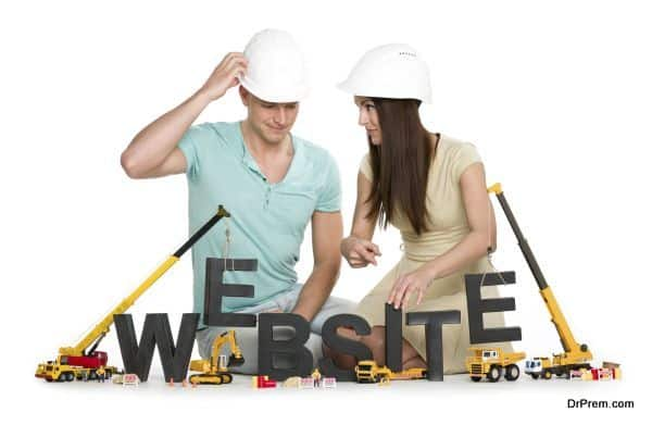 Website under construction: Friendly man and woman building website-word.
