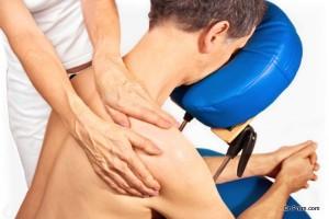 Man gets massage, reiki,acupressure on his  shoulder