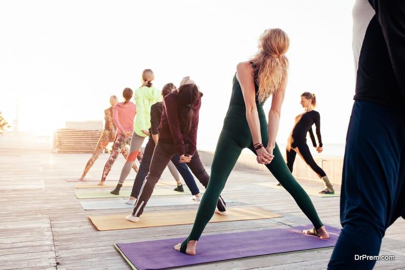 group of people practicing Yoga asanas