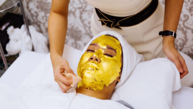 woman getting 24 karat gold facial treatment at the beauty clinic