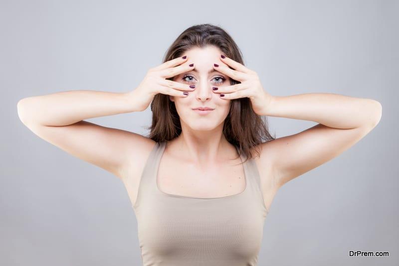 caucasian woman doing face yoga pose