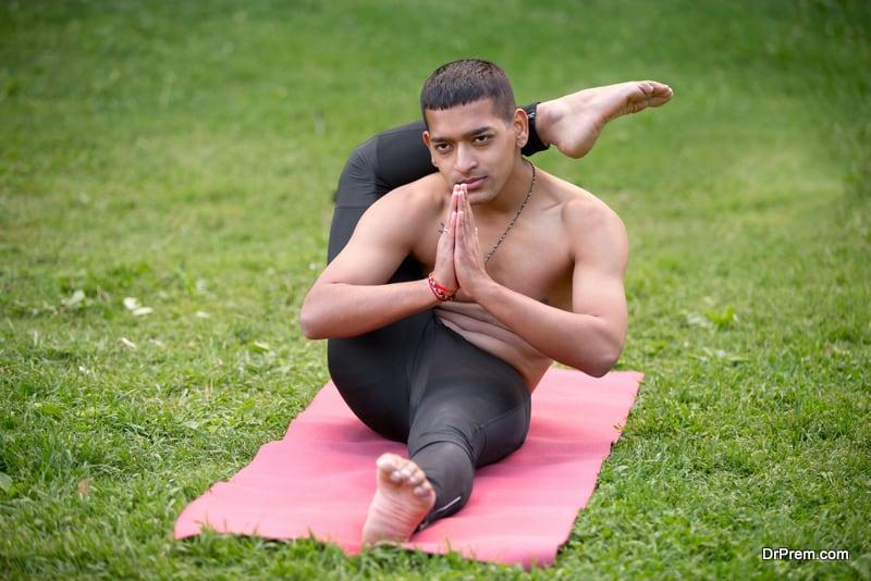 indian young man practicing yoga