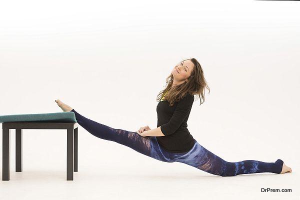 woman-doing-yoga-using-chair