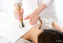 acupuncturist who treats a woman's back